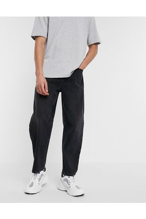 ASOS Relaxed tapered jeans in black