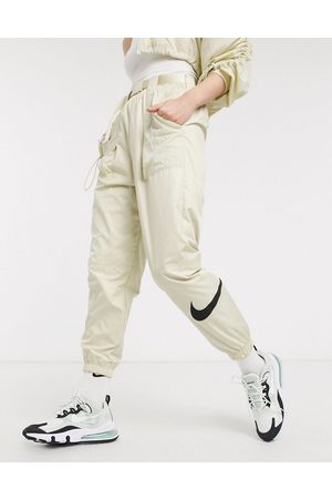 Nike Woven swoosh cargo pants with belt in off white