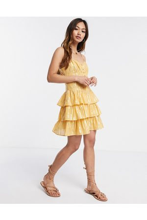 ASOS Button front mini tiered sundress in metallic stripe in mustard-Yellow
