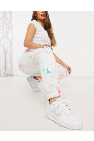 Jaded London Oversized joggers in grunge tie-dye and graphics co-ord-White