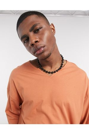 ASOS Oversized long sleeve t-shirt with raw notch neck in rust-Orange