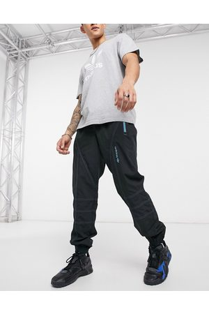 adidas Adventure joggers with contrast stitch in black