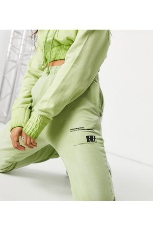 COLLUSION Text print bleached wash skinny joggers co-ord in green