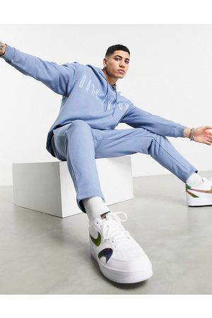 ASOS Dark Future Tracksuit in blue with chest logo