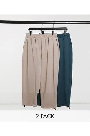 ASOS Super oversized joggers with toggle hem in beige/teal 2 pack-Multi