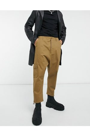 ASOS Drop crotch cargo trousers in brown with toggles-Green