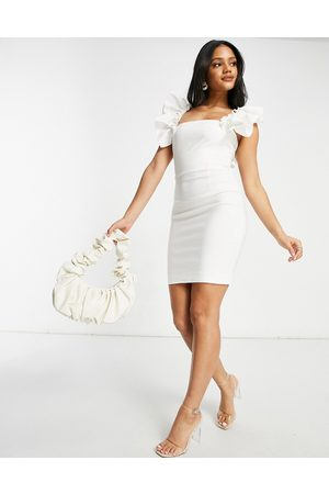Vesper Mini dress with exaggerated sleeve in white