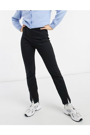 & OTHER STORIES Slim leg trousers with split front in black