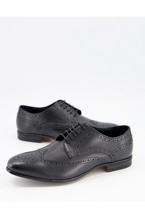 Schuh Rowen brogues in black leather