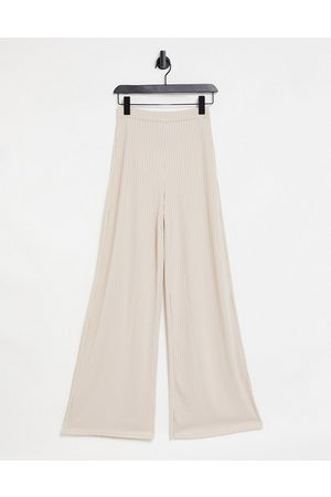 Club L Ribbed flared trousers in cream co-ord-Pink