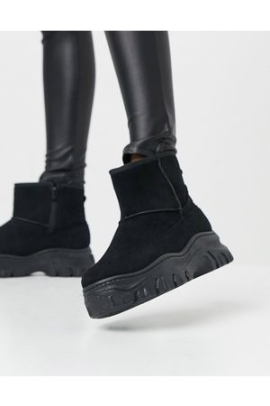 Truffle Collection Faux fur lined ankle boots in black