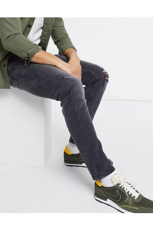 ASOS Stretch slim jeans in washed black with knee rip and abrasions