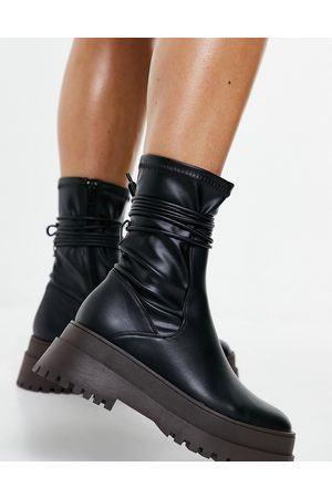 Public Desire Finale chunky flat ankle boots with tie in black and brown