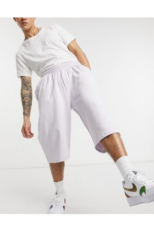 ASOS Oversized longer length jersey shorts in lilac-Purple