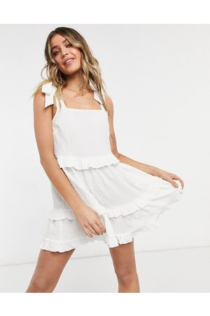ASOS Textured ruffle swing mini sundress with tie straps in white