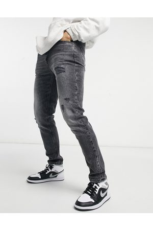 adidas Slim jeans with rips in washed black