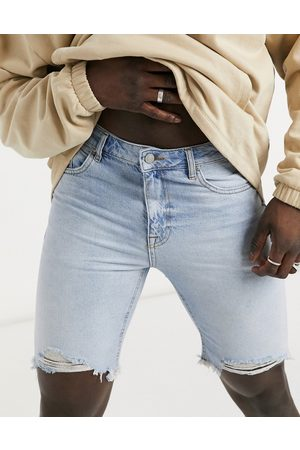 ASOS Slim denim shorts in light wash blue with raw hem