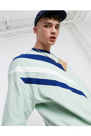 ASOS Oversized t-shirt in green with chevron colour block