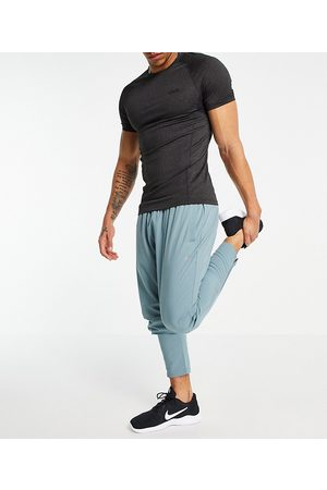 ASOS Woven skinny tapered running joggers with reflective zip detail-Grey