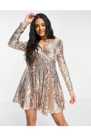 Club L Wrap front sequin skater dress in gold