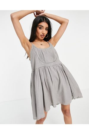 ASOS Mini cami smock sundress with pin tucks and crochet lace in washed grey
