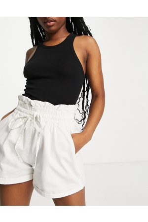 Missguided Denim shorts with tie waist in white
