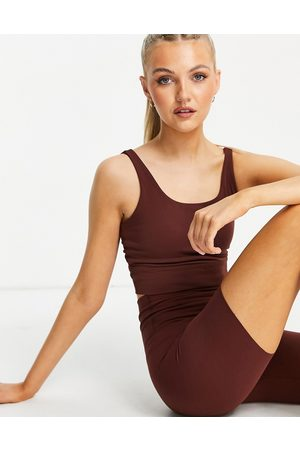 Nike Nike Yoga luxe light support cropped tank in bronze-Brown