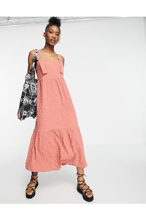 ASOS Dungaree midi sundress in bubble texture in pink