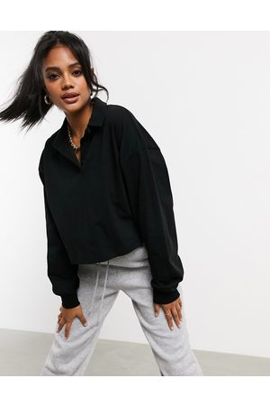 ASOS Boxy crop polo t-shirt with long sleeve in black