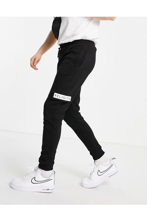 Religion Patch logo cadet joggers in black