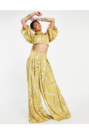 ASOS Pleat front wide leg palazzo trouser in yellow leaf print-Pink