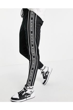 The Couture Club Taped track joggers in black