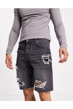 ASOS Slim denim shorts in washed black with heavy rips