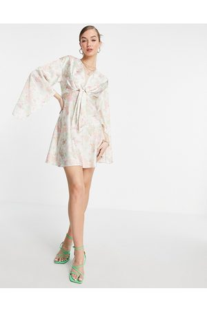 ASOS Cape sleeve satin mini dress with knot front in cream floral-White