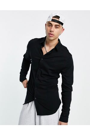 River Island Long sleeve jersey muscle fit shirt in black
