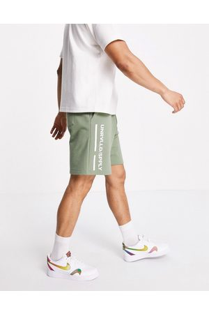 ASOS ASOS Unrvlld Spply co-ord relaxed shorts in green with logo print