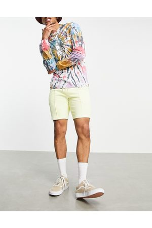 ASOS Co-ord slim jersey shorts with pin tucks in yellow