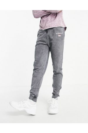 ASOS Co-ord tapered joggers in black acid wash with Illinois city print