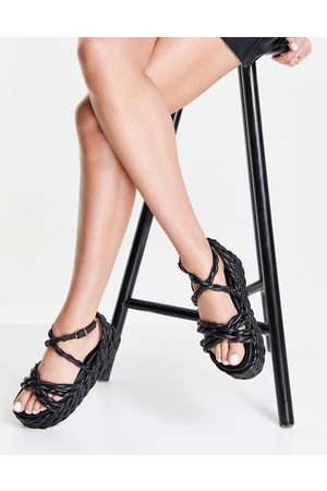 ASRA Prince chunky twisted flatform sandals in black leather