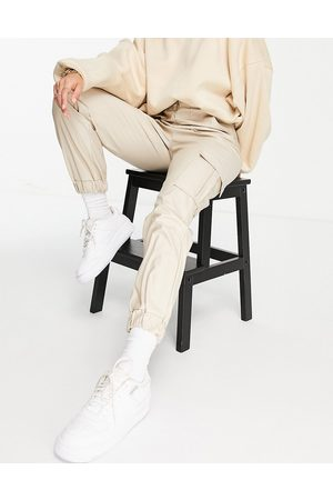 Parisian PU joggers with pocket details in stone-Neutral