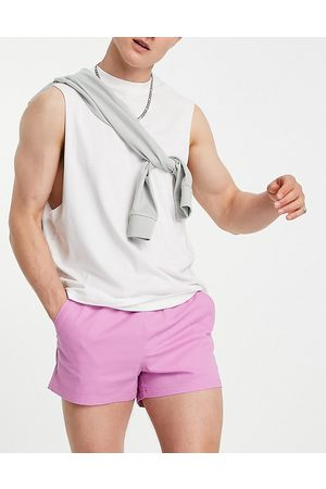 ASOS Skinny super short chino shorts with elasticated waist in bright pink