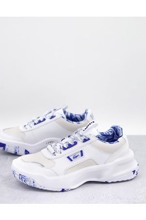 Lacoste Ace Lift leather chunky marble trainers in white and blue