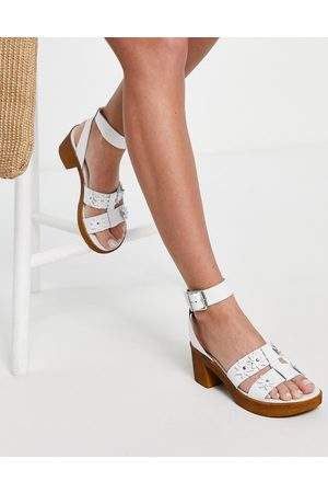 ASOS Twist leather daisy clogs in white