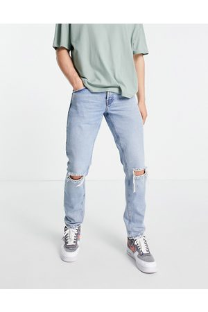 ASOS Organic cotton blend slim jeans in 90's stone wash with knee rips-Blue