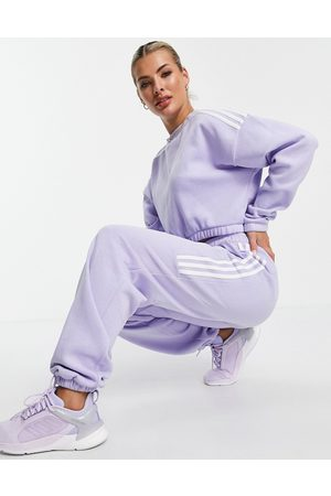 adidas Adidas Training oversized joggers with three stripes in lilac-Purple