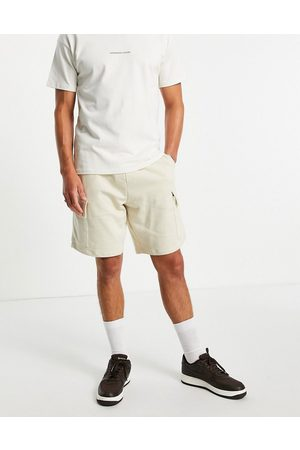 ASOS DESIGN Oversized jersey shorts with cargo pocket in grey