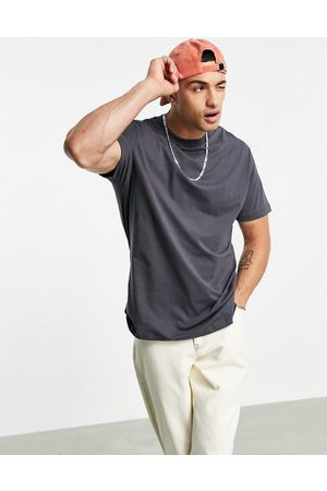 ASOS Relaxed longline t-shirt with curved hem in washed black-Grey
