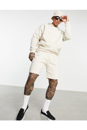 ASOS Oversized tracksuit with hoodie and shorts with pleats in beige-Neutral