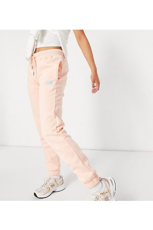 New Balance Joggers in pink- exclusive to ASOS