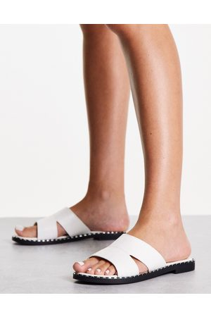 Schuh Topaz slide sandals with studding in white